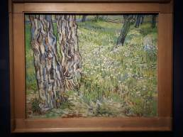 VINCENT VAN GOGH (1853 - 1890) Tree trunks in the grass. 1890.